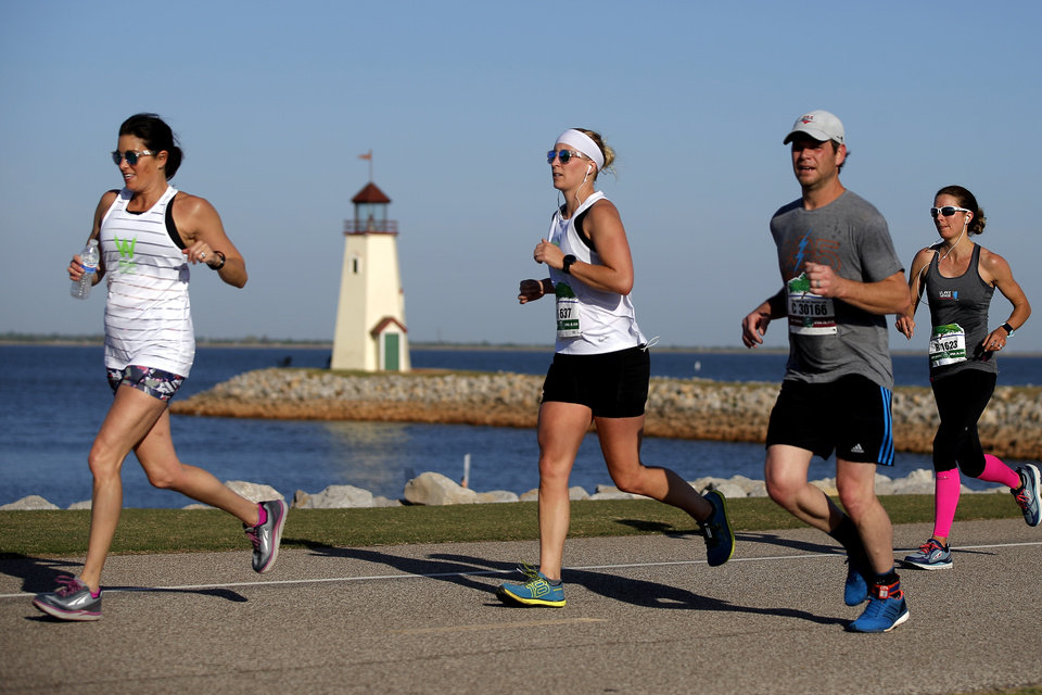 Photo - Runners make their way around Lake Hefner during the Oklahoma City Memorial Marathon in Oklahoma City, Sunday, April 29, 2018. Photo by Bryan Terry, The Oklahoman