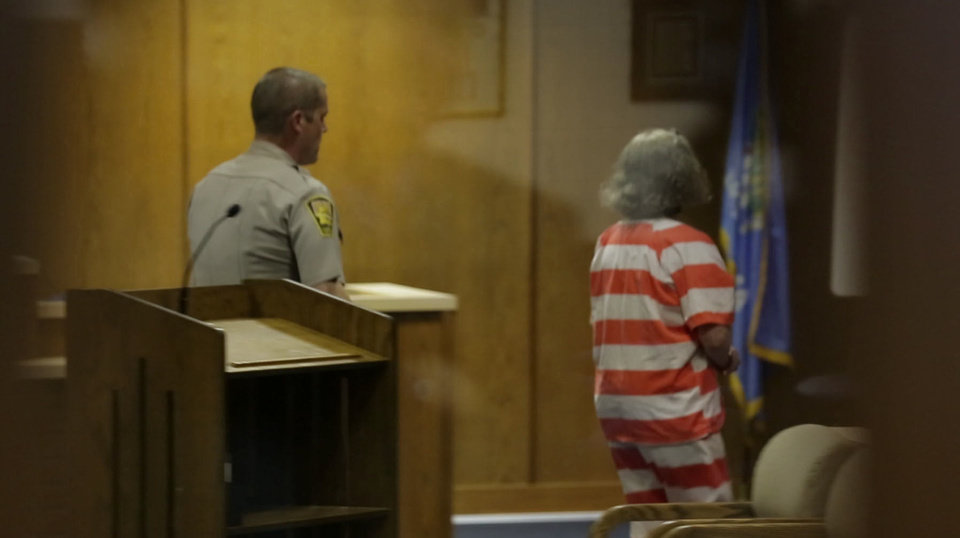 Photo - Convicted murderer Rebecca Bryan is escorted from a Canadian County courtroom Tuesday after meeting with her attorney after her sentencing.  Greg Singleton - The Oklahoman