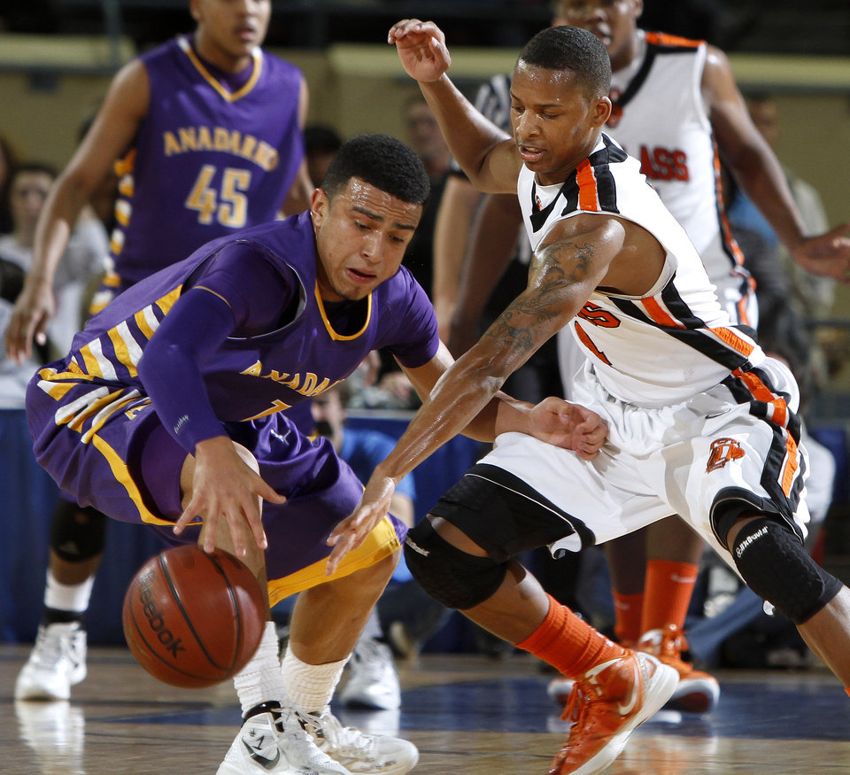 Photo - Anadarko's Sheldon Wilson, left, tries to get by Deangelo Smith of Douglass during the Class 4A boys high school state basketball championship game at State Fair Arena in Oklahoma City, Saturday, March 10, 2012. Photo by Bryan Terry, The Oklahoman