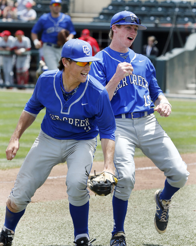 Photo - Deer Creek's Jordan Boyer, left, and Bryson Bowers celebrate play in the Class 5A baseball semifinal between Deer Creek and Claremore in high school state championships at L. Dale Mitchell Park on May 16, 2014 in Norman, Okla. Photo by Steve Sisney, The Oklahoman