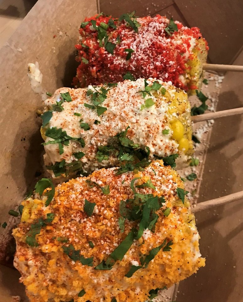 Photo - A selection of elotes from Taqueria El Camino. [Dave Cathey/The Oklahoman]