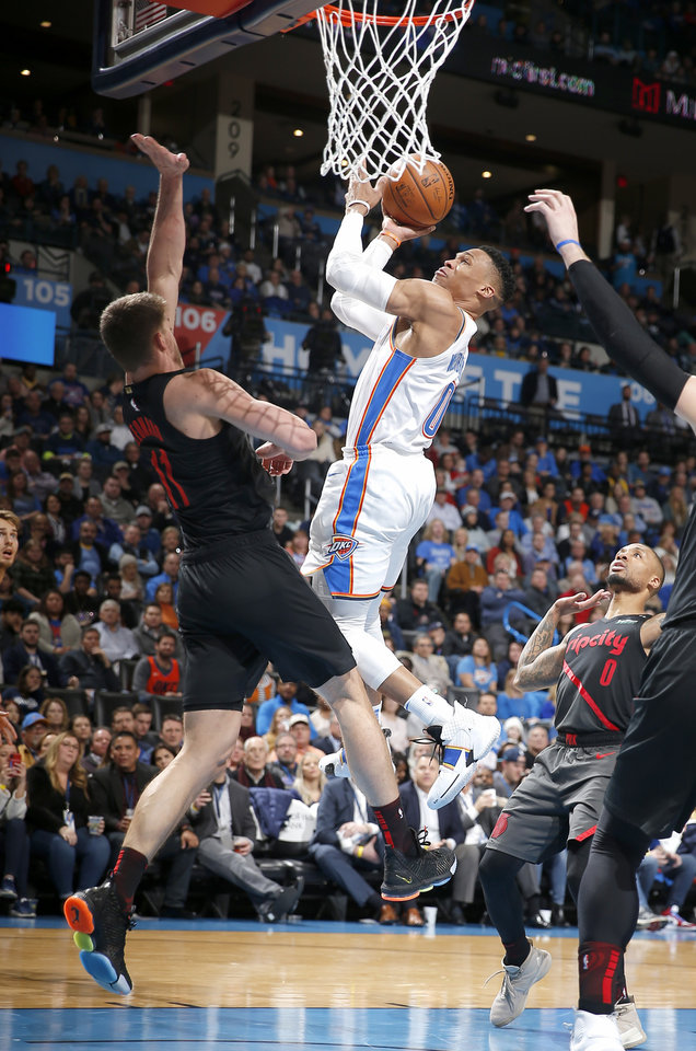 Photo - Oklahoma City's Russell Westbrook (0) goes up for a basket as Portland's Meyers Leonard (11) defends during the NBA basketball game between the Oklahoma City Thunder and the Portland Trail Blazers at Chesapeake Energy Arena in Oklahoma City, Tuesday, Jan. 22, 2019. Photo by Sarah Phipps, The Oklahoman