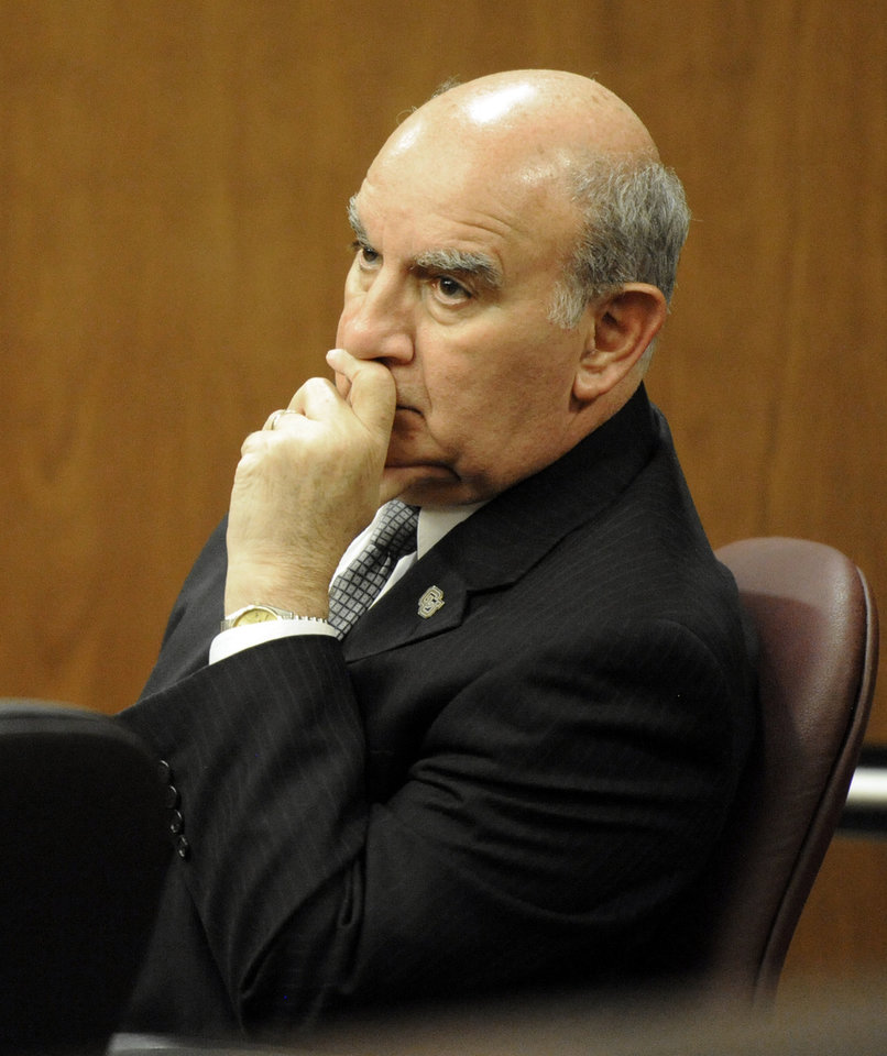 Photo -   University of Colorado Chancellor Phil DiStefano listens to the words of Denver-based attorney Robert Corry while he examines a witness during the hearing for the 4/20 closure of the Norlin Quad on the University of Colorado campus at the Boulder County Justice Center on Thursday, April 19, 2012, in Boulder, Colo. A judge says the University of Colorado-Boulder can close its grounds to unauthorized visitors Friday, as administrators try to stifle an unsanctioned annual campus celebration of marijuana. (AP Photo/The Daily Camera, Jeremy Papasso, Pool)