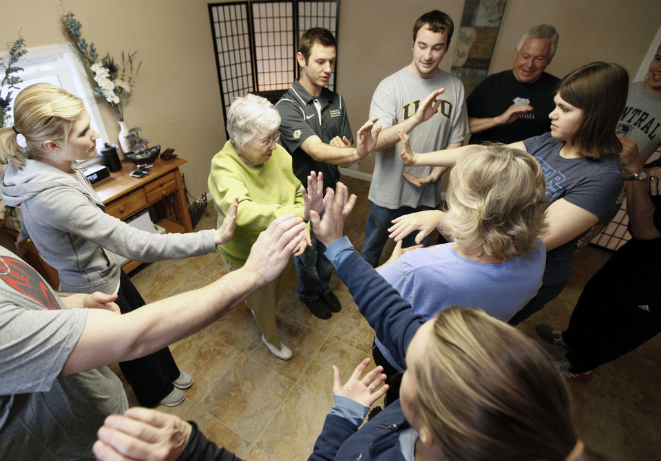 Photo - Students and instructors go through a routine during a tai chi class for seniors at the Ntouch Medical Massage and Spa in Edmond.  Photo By Paul Hellstern, The Oklahoman  PAUL HELLSTERN - Oklahoman