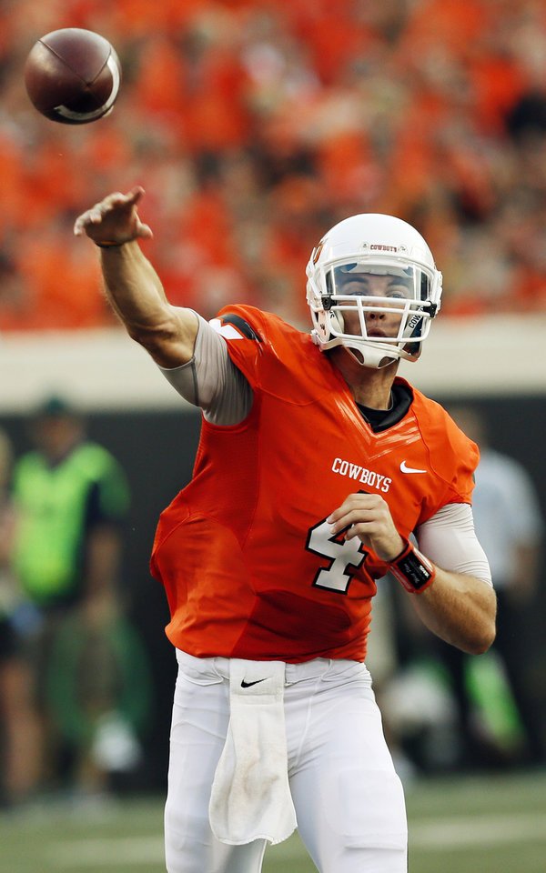 Photo - OSU's J.W. Walsh (4) passes during a college football game between Oklahoma State University (OSU) and Savannah State University at Boone Pickens Stadium in Stillwater, Okla., Saturday, Sept. 1, 2012. Photo by Nate Billings, The Oklahoman