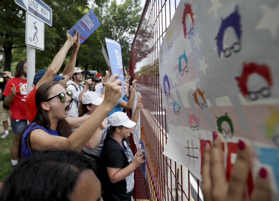 Photo - Supporters of Sen. Bernie Sanders, I-Vt., yell at delegates through the fence at Franklin Delano Roosevelt Park in Philadelphia, Tuesday, July 26, 2016, during the second day of the Democratic National Convention. (AP Photo/Matt Slocum)