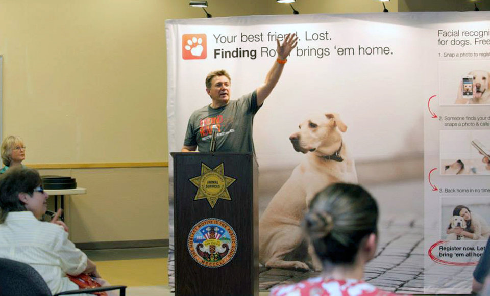 Photo - This May 16, 2014 photo provided by FindingRover.com shows founder of the smart phone application Finding Rover John Polimeno during a news conference in San Diego.  In May, San Diego County Animal Services became the first shelter system in the country to adapt the facial recognition plan. Every dog entering the county's three shelters will be put in the database. (AP Photo/FindingRover.com)