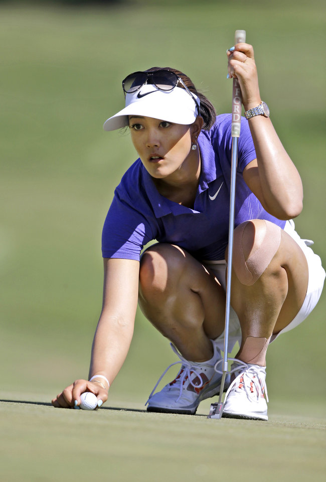 Photo - Michelle Wie lines up a putt on the first hole during the third round of the North Texas LPGA Shootout golf tournament at the Las Colinas Country Club in Irving, Texas, Saturday, May 3, 2014. (AP Photo/LM Otero)