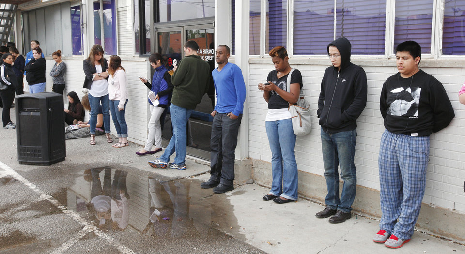Photo - Applicants wait in line for the Okla. Department of Public Safety driver license testing facility to open in downtown Edmond Friday, May 10, 2013.  Photo by Paul B. Southerland, The Oklahoman