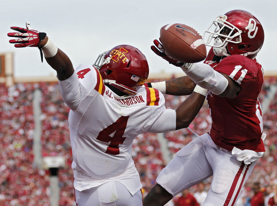 Iowa State's Sam E. Richardson (4) breaks up a pass for Oklahoma's Lacoltan Bester (11) during the college football game between the University of Oklahoma Sooners (OU) and the Iowa State University Cyclones (ISU) at Gaylord Family-Oklahoma Memorial Stadium in Norman, Okla. on Saturday, Nov. 16, 2013. Photo by Chris Landsberger, The Oklahoman