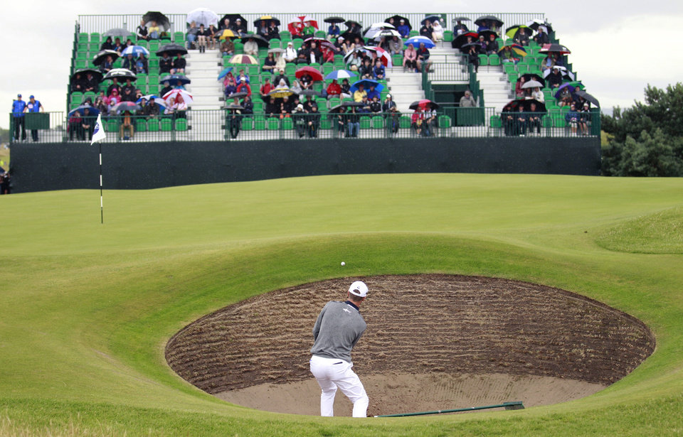 Photo - John Senden of Australia plays out of the bunker onto the 6th green during a practice round ahead of the British Open Golf championship at the Royal Liverpool golf club, Hoylake, England, Wednesday July 16, 2014. The British Open Golf championship starts Thursday July 17. (AP Photo/Peter Morrison)