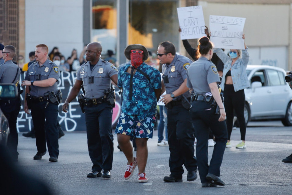 Photo - Oklahoma City Police arrest an alleged agitator Saturday, May 30, 2020, near NW 23rd and Classen in Oklahoma City. Photo by Sarah Phipps