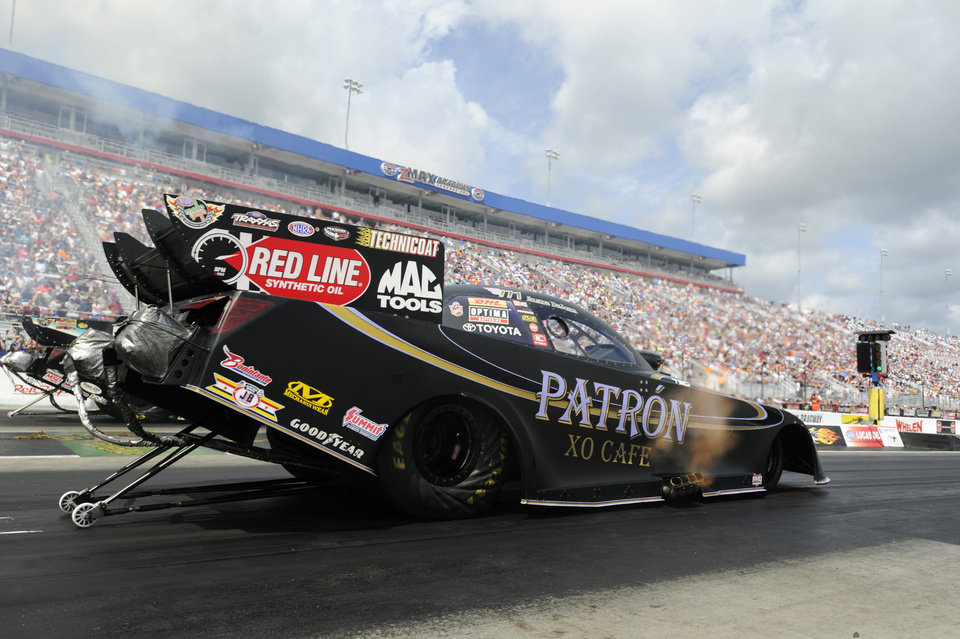 Photo - In this photo provided by the NHRA, Alexis DeJoria races to the No. 1 qualifying position in Funny Car at the Pep Boys NHRA Carolina Nationals drag races at zMAX Dragway on Saturday, Sept. 13, 2014, in Concord, N.C. She opens eliminations against Dave Richards. (AP Photo/NHRA, Marc Gewertz)