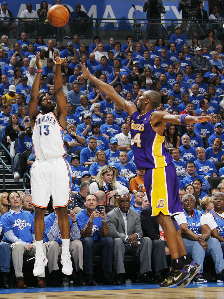 Photo - Oklahoma City's James Harden (13) shoots past Kobe Bryant (24) of L.A. in the first half during the basketball game between the Los Angeles Lakers and the Oklahoma City Thunder in the first round of the NBA playoffs at the Ford Center in Oklahoma City, Thursday, April 22, 2010. [Nate Billings/The Oklahoman]