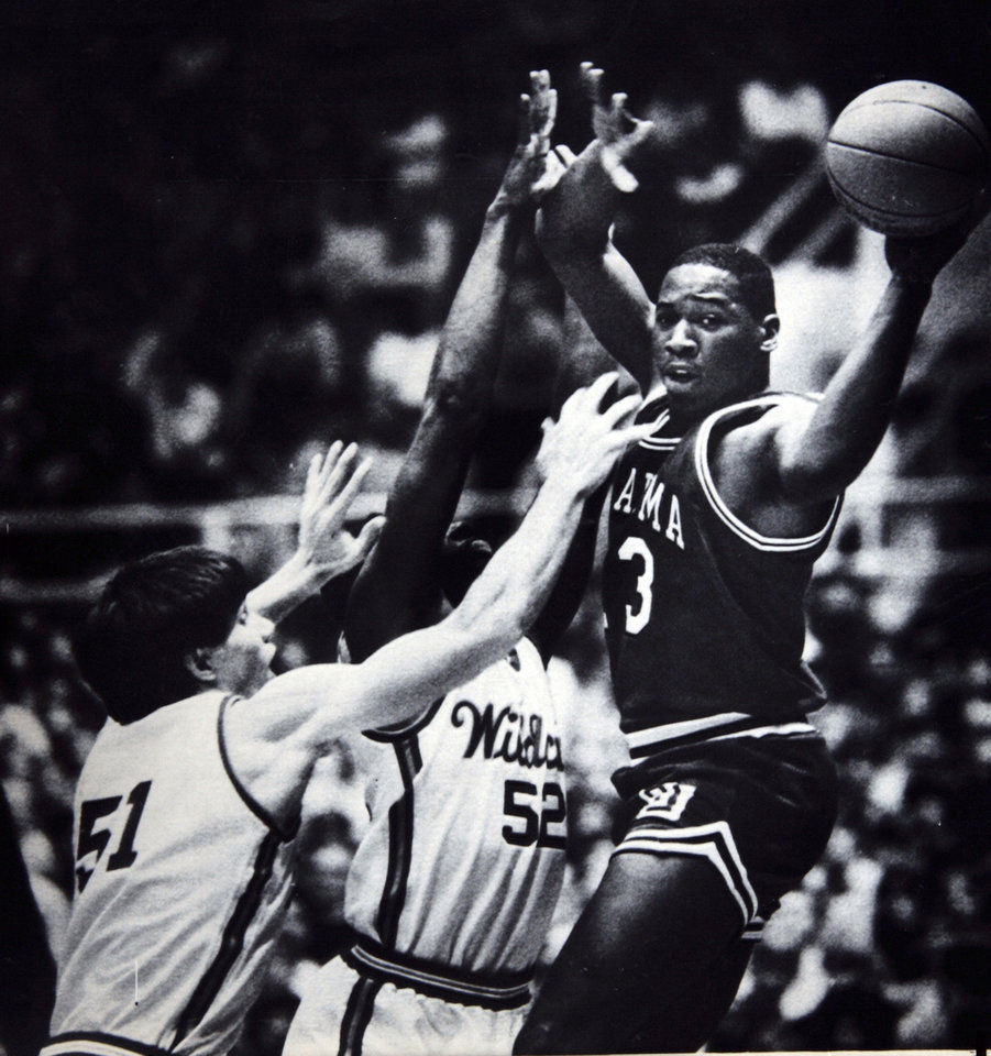 Former OU basketball player Wayman Tisdale. Wayman Tisdale has to deal with pressure from Kansas State's Kevin Muff and Alex Williams (52). Photo taken unknown, Photo published 2-10-1985 in The Daily Oklahoman. ORG XMIT: KOD