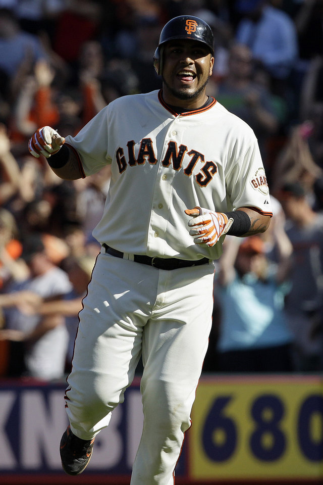Photo -   San Francisco Giants' Hector Sanchez celebrates after his run-scoring base hit off of Milwaukee Brewers pitcher Tim Dillard during the 11th inning of a baseball game in San Francisco, Sunday, May 6, 2012. The Giants won 4-3 in 11 innings. (AP Photo/Jeff Chiu)
