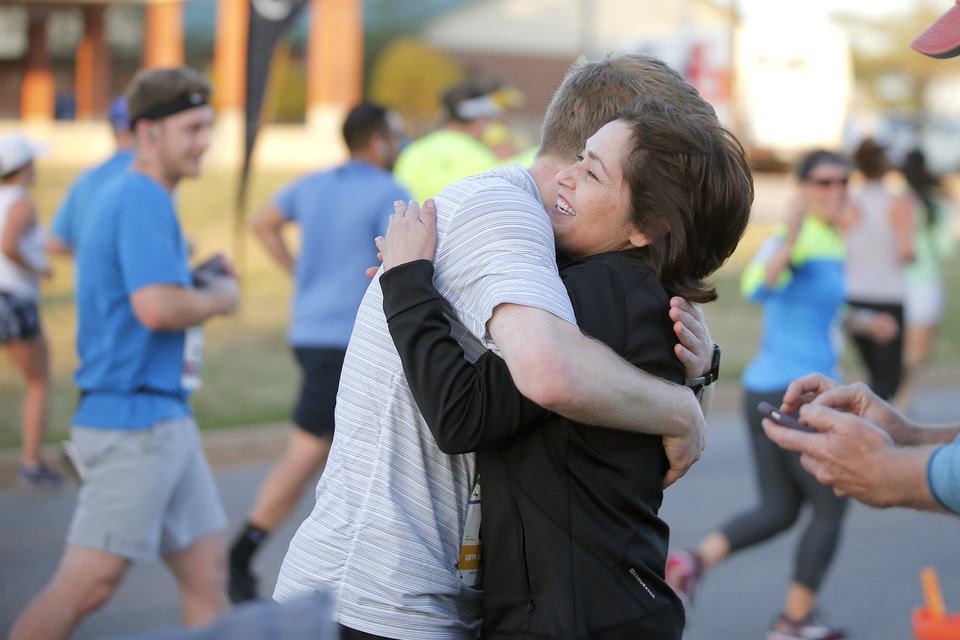 Photo - Luveni Goodrich hugs her friend runner Forrest Pinkerton just south of the state Capitol on Lincoln Blvd. during the Oklahoma City Memorial Marathon in Oklahoma City, Sunday, April 29, 2018. Photo by Bryan Terry, The Oklahoman