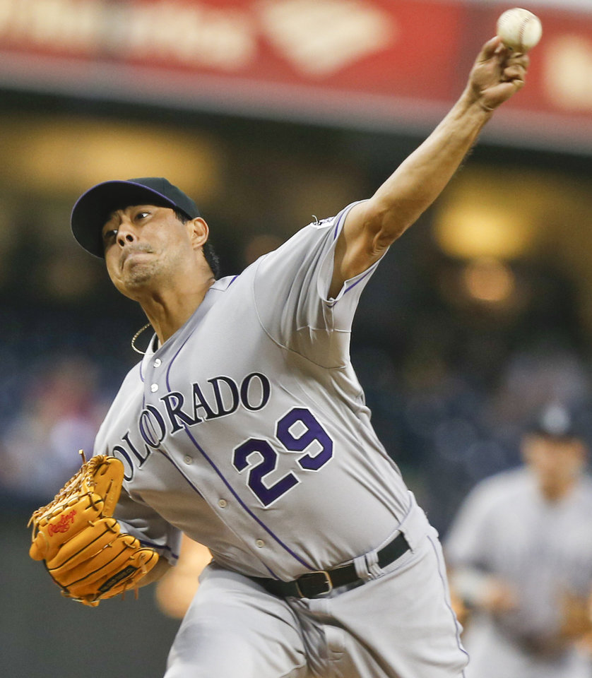 Photo - Colorado Rockies starting pitcher Jorge De La Rosa works against the San Diego Padres in the first inning of a baseball game Wednesday, April 16, 2014, in San Diego.  (AP Photo/Lenny Ignelzi)