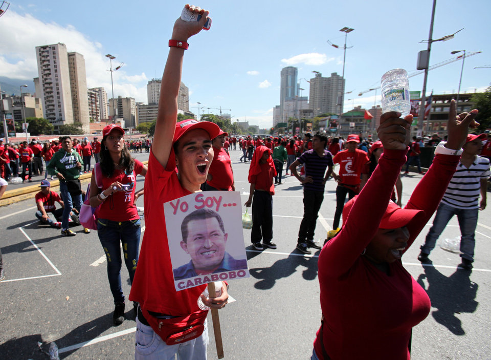 Supporters of Venezuela\'s President Hugo Chavez shout slogans during a rally in Caracas, Venezuela, Saturday, Jan. 26, 2013. Venezuelan President Hugo Chavez\'s condition has improved and he is now optimistic as he faces more treatment following cancer surgery, his vice president said Saturday. (AP Photo/Fernando Llano)