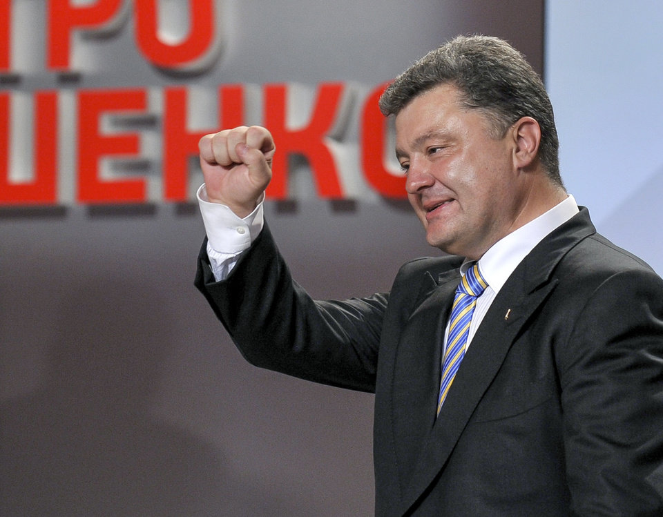 Photo - Ukrainian presidential candidate Petro Poroshenko  reacts during his press conference in Kiev, Ukraine, Sunday, May 25, 2014. An exit poll showed that billionaire candy-maker Petro Poroshenko won Ukraine's presidential election outright Sunday in the first round — a vote that authorities hoped would unify the fractured nation. (AP Photo/Mykola Lazarenko, Pool)