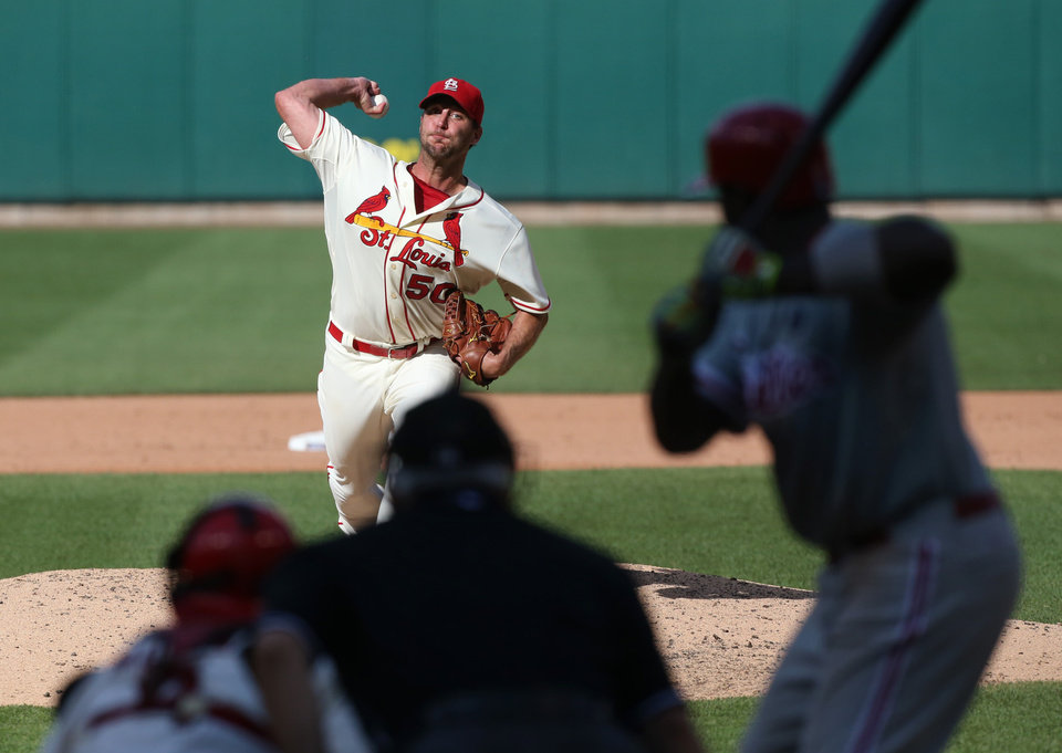 Photo - St. Louis Cardinals starter Adam Wainwright pitches against the Philadelphia Phillies during a baseball game Saturday, June 21, 2014, in St. Louis. The Cardinals won 4-1. (AP Photo/St. Louis Post-Dispatch, Chris Lee)