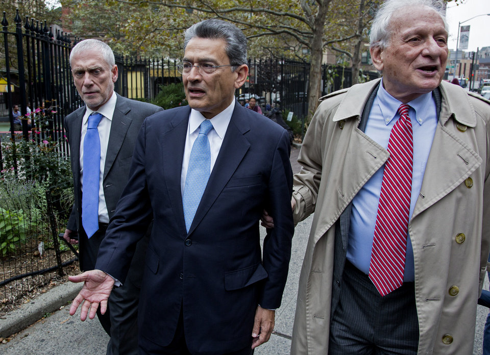 Photo -   Former Goldman Sachs and Procter & Gamble Co. board member Rajat Gupta, center, arrives outside court in New York Wednesday, Oct. 24, 2012. Gupta is to be sentenced after being found guilty insider trading by passing secrets between March 2007 and January 2009 to a billionaire hedge fund founder who used the information to make millions of dollars. At right is Gupta's attorney Gary Naftalis. (AP Photo/Craig Ruttle)