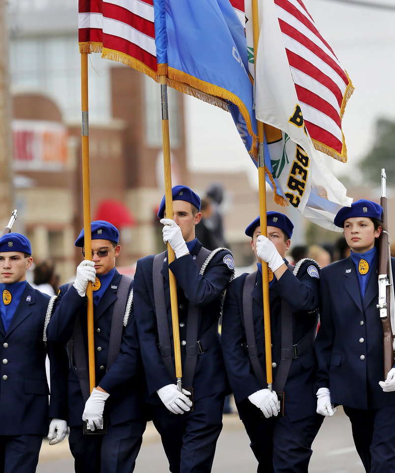 AFJROTC Honor Guard lead the parade.    From left, Skyler Lounge, Carley Henninger, Mark Nelson, Jacob Cantrell and Melissa Ferguson. The Midwest City High School  homecoming parade photographed on SE 15 Street Friday afternoon, Oct. 18, 2013.   Photo by Jim Beckel,  The Oklahoman.