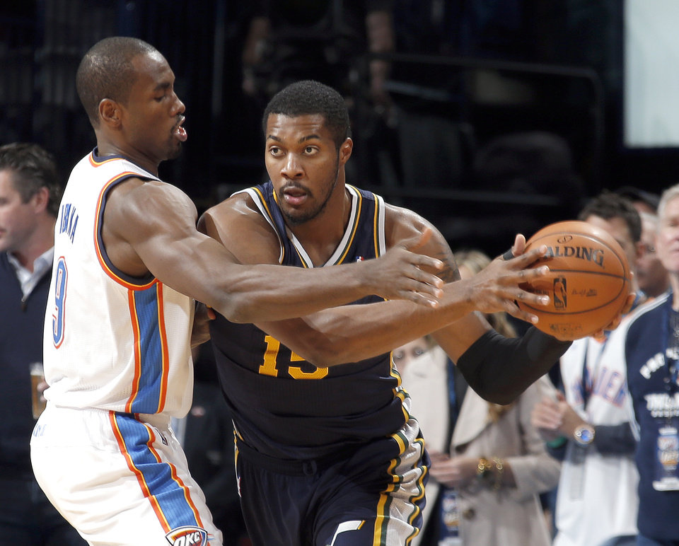 Oklahoma City's Serge Ibaka (9) defense against Utah's Derrick Favors (15) during the NBA game between the Oklahoma City Thunder and the Utah Jazz at the Chesapeake Energy Arena, Sunday, Nov. 24, 2013. Photo by Sarah Phipps, The Oklahoman