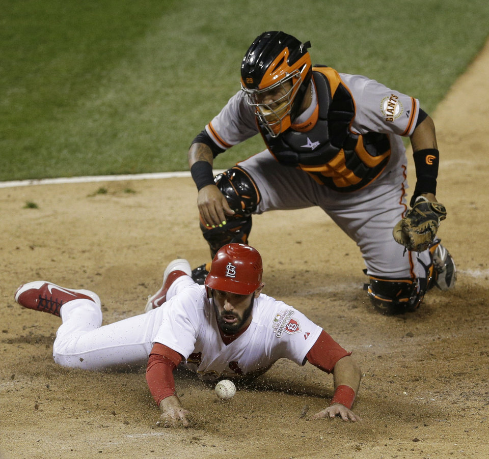 Photo -   San Francisco Giants catcher Hector Sanchez can't handle the throw as St. Louis Cardinals' Matt Carpenter scores from second on a single by Matt Holliday during the fifth inning of Game 4 of baseball's National League championship series Thursday, Oct. 18, 2012, in St. Louis. (AP Photo/Patrick Semansky)
