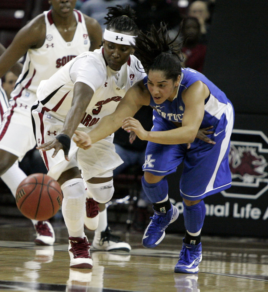 Kentucky's Jennifer O'Neill (0) battles for a loose ball with South Carolina's Khadijah Sessions (5) during the first half of their NCAA college basketball game, Thursday, Jan. 24, 2013, in Columbia, S.C. (AP Photo/Mary Ann Chastain)