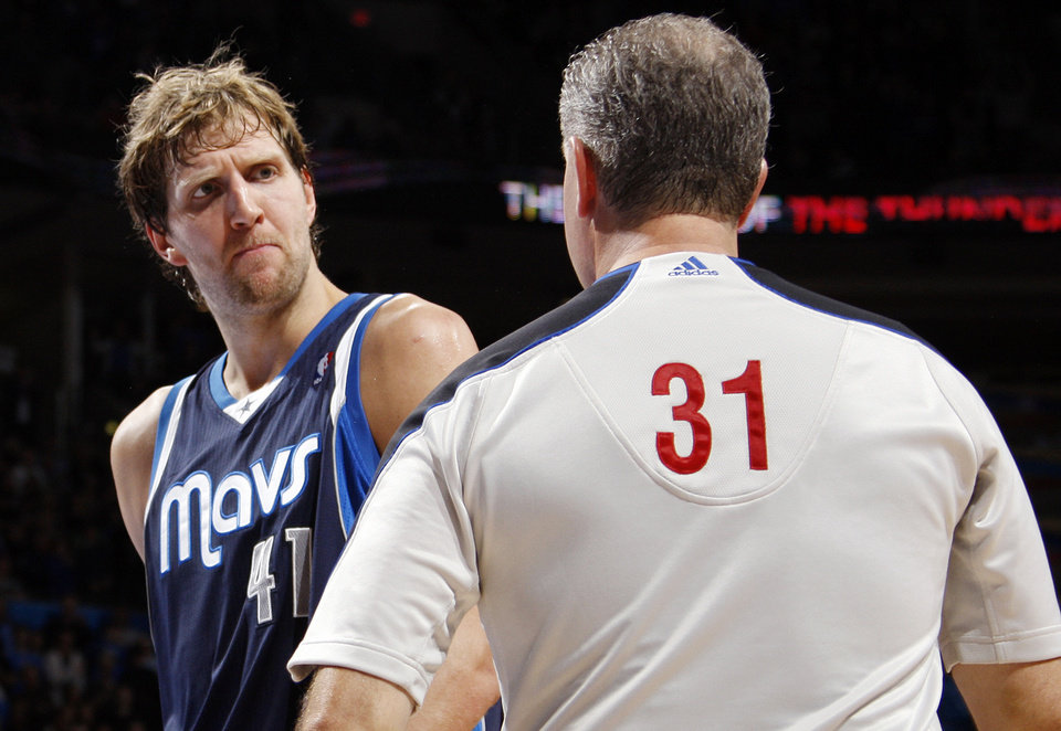 Photo - Dirk Dowitzki (41) of Dallas talks to official Scott Wall before getting a technical foul in the fourth quarter during an NBA basketball game between the Oklahoma City Thunder and the Dallas Mavericks at Chesapeake Energy Arena in Oklahoma City, Thursday, Dec. 29, 2011. Oklahoma City won, 104-102. Photo by Nate Billings, The Oklahoman