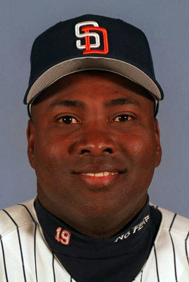 Photo - FILE - This 1999 file photo shows San Diego Padres' Tony Gwynn. The Baseball Hall of Fame says Gwynn died of cancer on Monday, June 16, 2014. He was 54. (AP Photo/File)