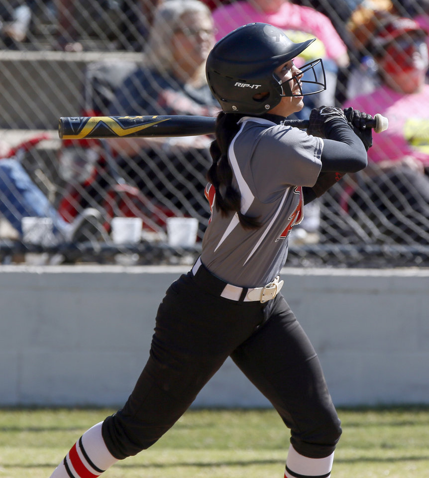 Photo - Purcell's Chelsea Spain (8) hits a home run in the sixth inning to give Purcell a 10-0 win over Hilldale in a Class 4A high school softball game during the semifinals of the state fastpitch softball tournament at the Ballfields at Firelake in Shawnee, Okla., Friday, Oct. 18, 2019. [Nate Billings/The Oklahoman]