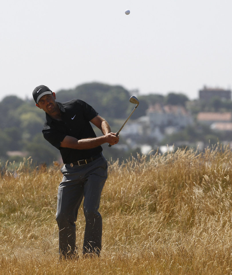 Photo - Charl Schwartzel of South Africa plays a shot on the 16th hole during the second round of the British Open Golf Championship at Muirfield, Scotland, Friday July 19, 2013. (AP Photo/Jon Super)