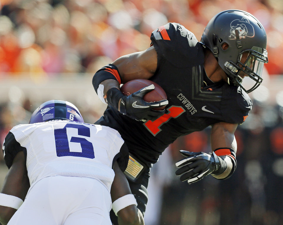 Photo - TCU's Elisha Olabode (6) tackles Oklahoma State's Joseph Randle (1) during a college football game between Oklahoma State University (OSU) and Texas Christian University (TCU) at Boone Pickens Stadium in Stillwater, Okla., Saturday, Oct. 27, 2012. Photo by Nate Billings, The Oklahoman