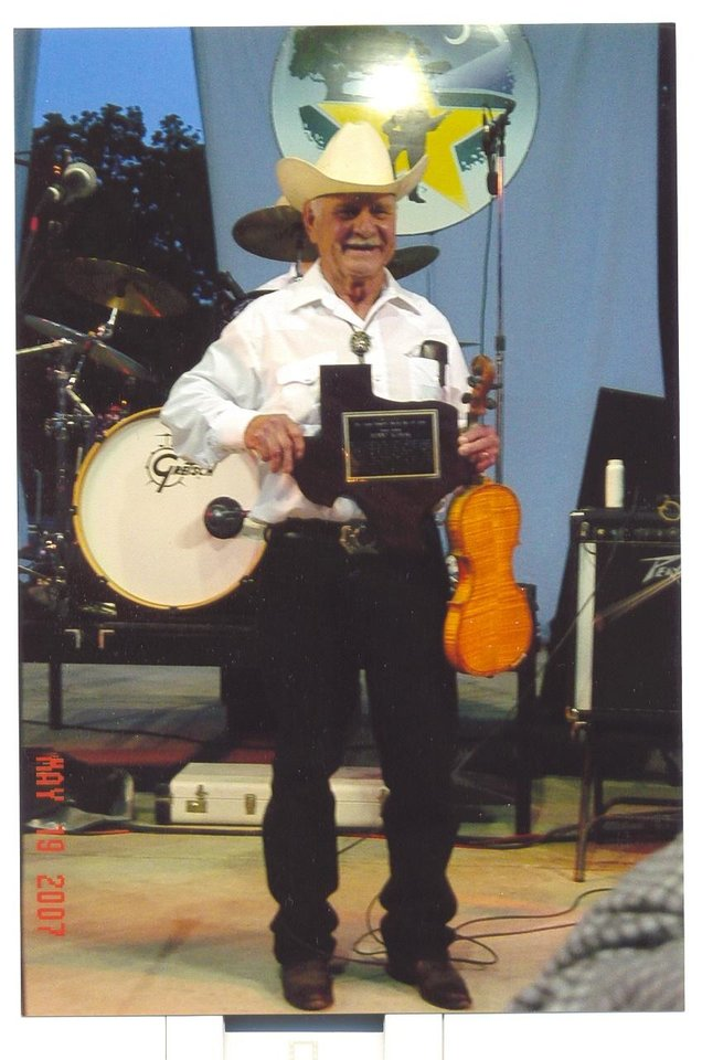 Benny Kubiak with his Texas-shaped plaque for induction into the Texas Western Swing Hall of Fame<br/><b>Community Photo By:</b> Courtesy of Benny Kubiak<br/><b>Submitted By:</b> Karen, Harrah