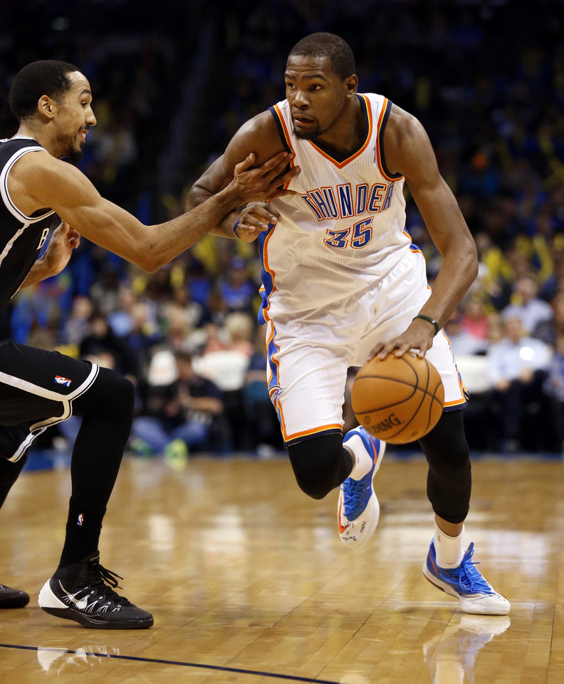 Thunder's Kevin Durant (35) drives past Brooklyn's Shaun Livingston in the second half of an NBA basketball game where the Oklahoma City Thunder were defeated 95-93 by the Brooklyn Nets at the Chesapeake Energy Arena in Oklahoma City, on Thursday, Jan. 2, 2014. Photo by Steve Sisney, The Oklahoman