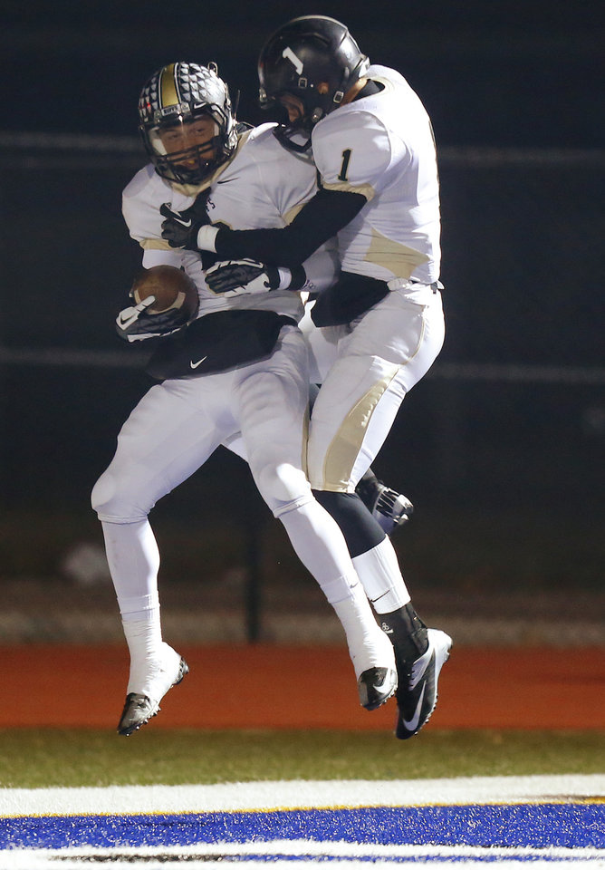 Photo - McAlester's Mason Bumphus, left, celebrates with Cade Harkins after a McAlester touchdown against Deer Creek during a high school football playoff game at Deer Creek, Friday, Nov. 16, 2012. Photo by Bryan Terry, The Oklahoman