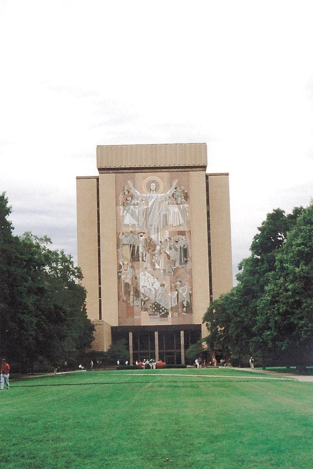 "Photo - Notre Dame's ""Touchdown Jesus"" -  In the background is the Hesburgh Library which features the mural nicknamed ""Touchdown Jesus"""