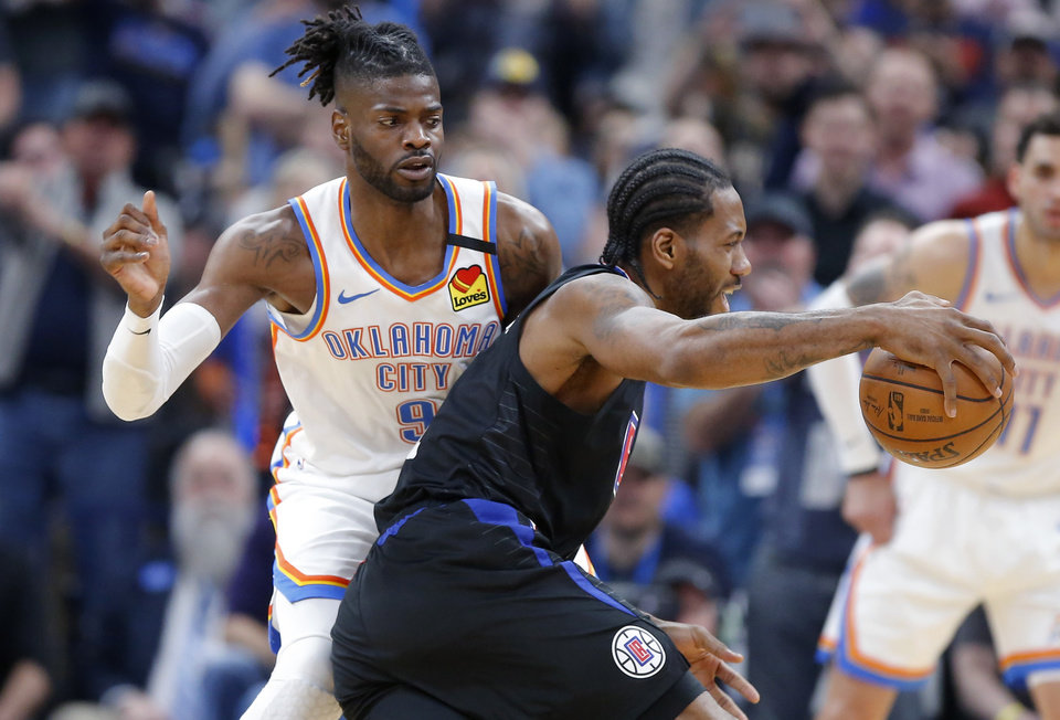 Photo - LA's Kawhi Leonard (2) goes past Oklahoma City's Nerlens Noel (9) during an NBA basketball game between the Oklahoma City Thunder and the Los Angeles Clippers at Chesapeake Energy Arena in Oklahoma City, Tuesday, March 3, 2020. [Bryan Terry/The Oklahoman]