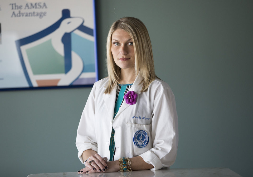 Photo -  Nida Degesys, National President of the American Medical Student Association, poses for photos in her office in Sterling, Va. Degesys graduated in May 2013 from Northeast Ohio Medical University with about $180,000 in loans.  AP Photo   Evan Vucci -  AP