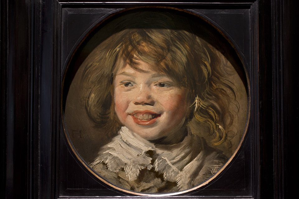 Photo - This reproduction shows Frans Hals' Laughing Boy (painted approximatetely 1625) at the renovated Mauritshuis museum during a preview for the press in The Hague, Netherlands, Friday, June 20, 2014. The Mauritshuis reopens after a two-year renovation that allowed its masterpieces, including Vermeer's The Girl with the Pearl Earring to be seen by record-setting crowds abroad. The public will have access for free from 8 pm till midnight on Friday June 27th after the official ceremonial opening and from June 28 onwards the museum will revert to regular opening hours. (AP Photo/Peter Dejong)