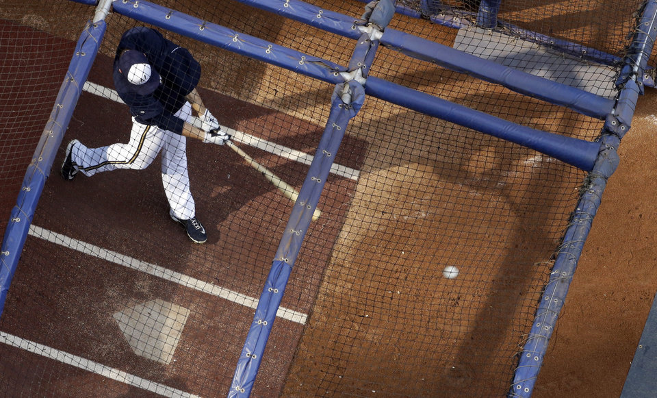 Milwaukee Brewers' Ryan Braun takes batting practice before a baseball game against the Cincinnati Reds Monday, July 8, 2013, in Milwaukee. (AP Photo/Morry Gash)