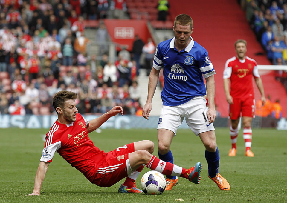 Photo - Southampton's Adam Lallana, left, and Everton's Ross Barkley try to control the ball during their English Premier League soccer match at St Mary's ground in Southampton, Saturday April 26, 2014. (AP Photo / Chris Ison, PA) UNITED KINGDOM OUT - NO SALES - NO ARCHIVES