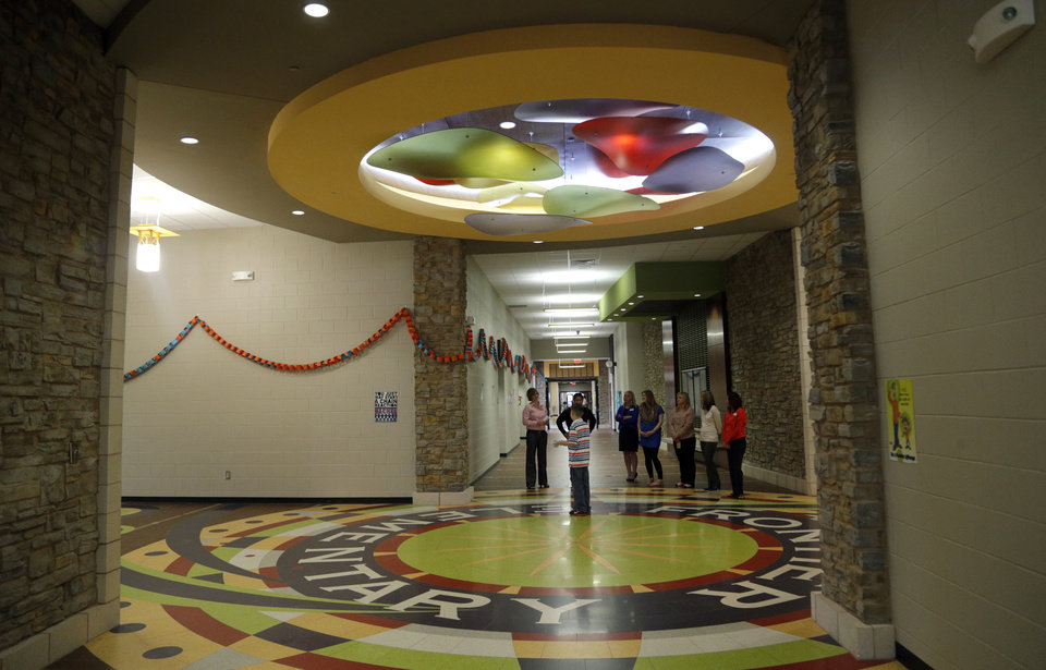 Photo -  Visitors tour Frontier Elementary in Edmond on Sunday. Photo by Sarah Phipps, The Oklahoman   SARAH PHIPPS -