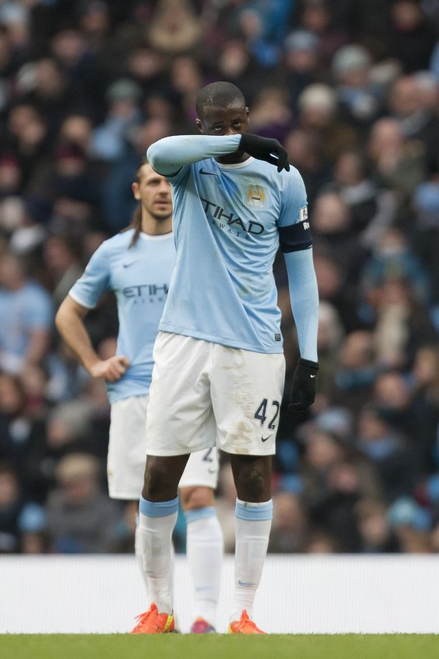 Photo - Manchester City's Yaya Toure wipes his face after Watford's second goal during their English FA Cup fourth round soccer match at The City of Manchester Stadium, Manchester, England, Saturday, Jan. 25, 2014. (AP Photo/Jon Super)