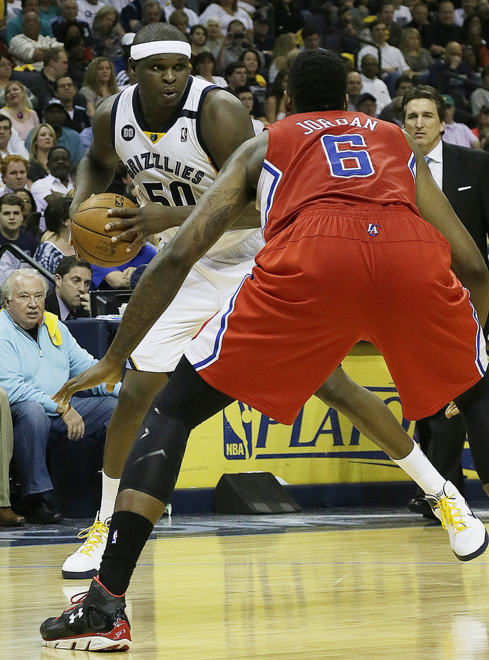 Memphis Grizzlies forward Zach Randolph (50) works against Los Angeles Clippers center DeAndre Jordan (6) during the second half of Game 3 in a first-round NBA basketball playoff series in Memphis, Tenn., Thursday, April 25, 2013. The Grizzlies defeated the Clippers 94-82. (AP Photo/Danny Johnston)