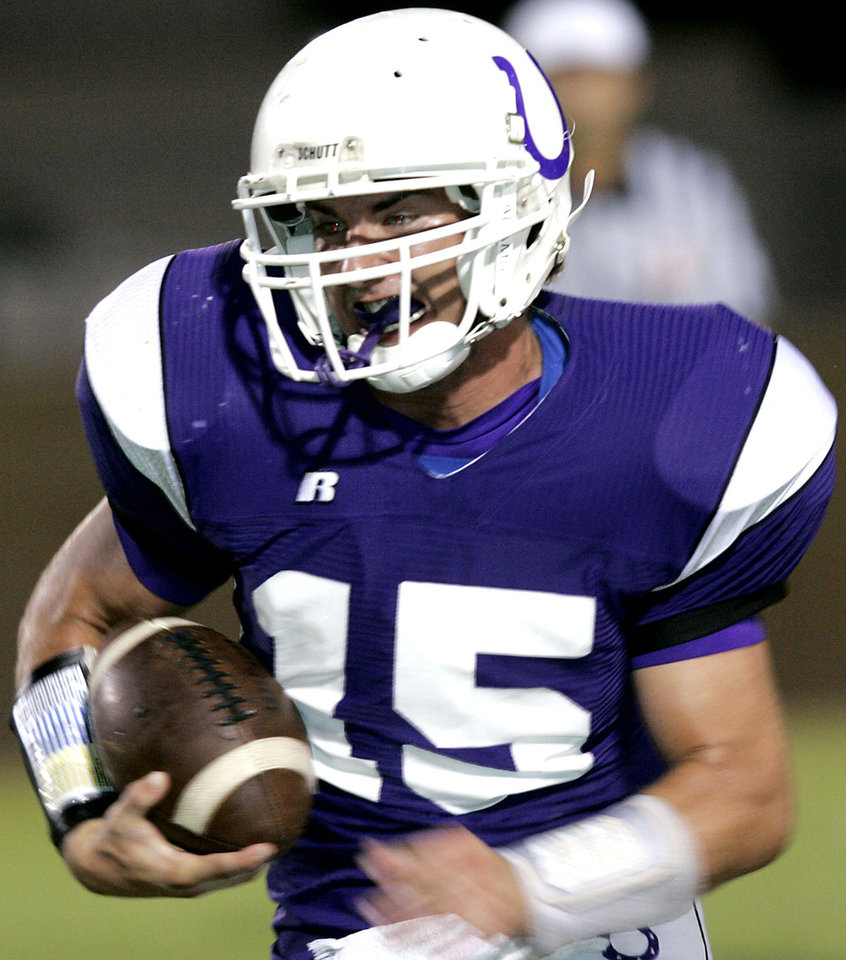 Photo -  Bethany's QB J.P. Grasmick takes the ball downfield during the Broncho's game against Bridge Creek on Friday, Oct. 5 2007. Photo by The Oklahoman Archives   John Clanton -  The OKlahoman