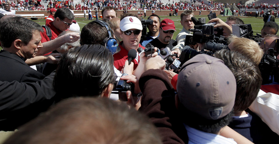 Photo - OU's  Bob Stoops talks to the media after Oklahoma's Red-White football game at The Gaylord Family - Oklahoma Memorial Stadiumin Norman, Okla., Saturday, April 11, 2009. Photo by Bryan Terry, The Oklahoman