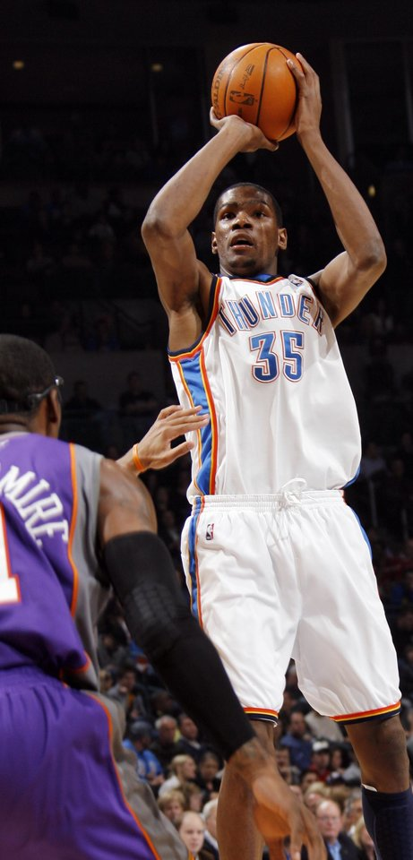 Photo - Oklahoma City's Kevin Durant (35) shoots during the NBA basketball game between the Phoenix Suns and the Oklahoma City Thunder at the Ford Center in Oklahoma City, Tuesday, Feb. 23, 2010. Photo by Nate Billings, The Oklahoman ORG XMIT: KOD